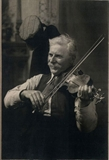 Michael J. Dunn playing fiddle